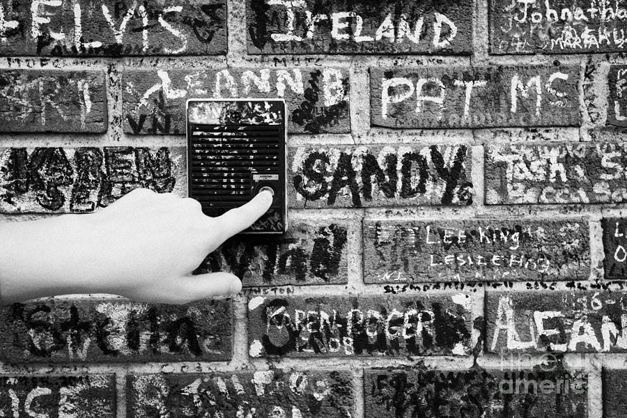 Womans Hand Pushing Old Intercom Button On Wall Covered In Graffiti Outside Graceland Memphis Photograph  - Womans Hand Pushing Old Intercom Button On Wall Covered In Graffiti Outside Graceland Memphis Fine Art Print