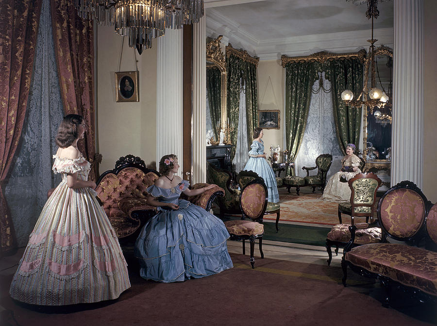 Women In Period Costumes Sit In An Photograph  - Women In Period Costumes Sit In An Fine Art Print