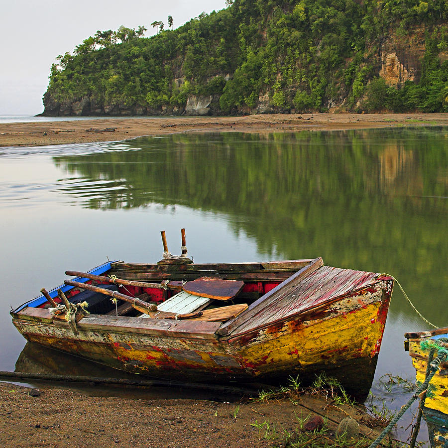 Wooden Boat- St Lucia is a photograph by Chester Williams which was ...