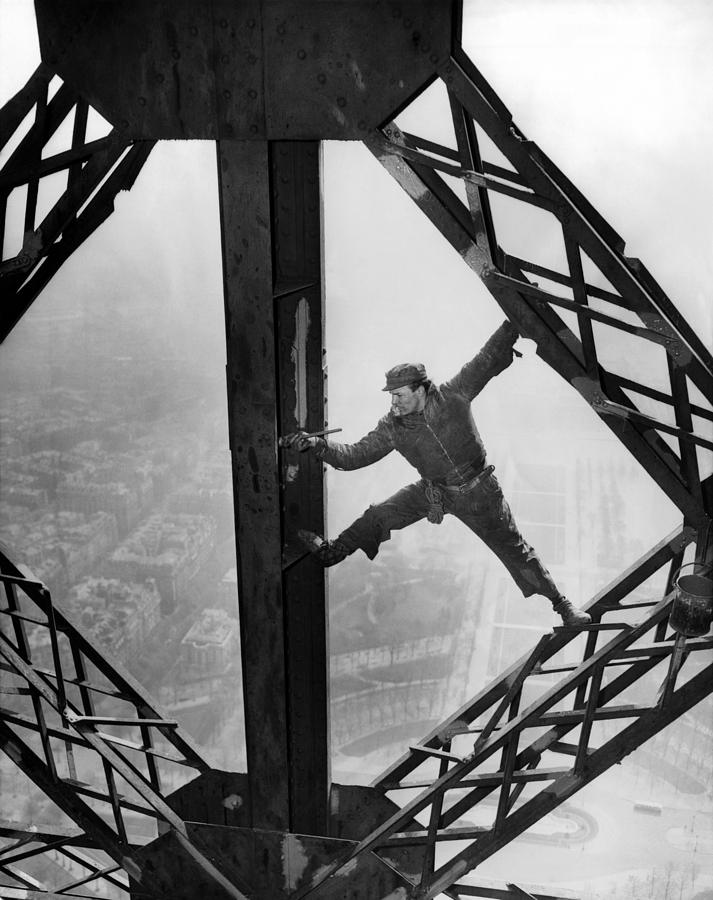 Worker Painting The Eiffel Tower Photograph
