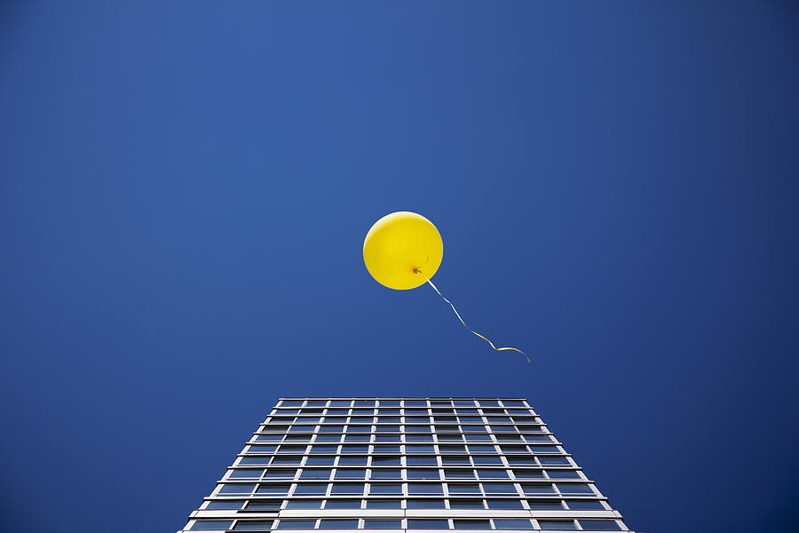 Yellow Balloon Floating Past Single Skyscraper Photograph  - Yellow Balloon Floating Past Single Skyscraper Fine Art Print