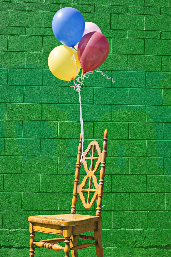 Yellow Cahir With Balloons Photograph