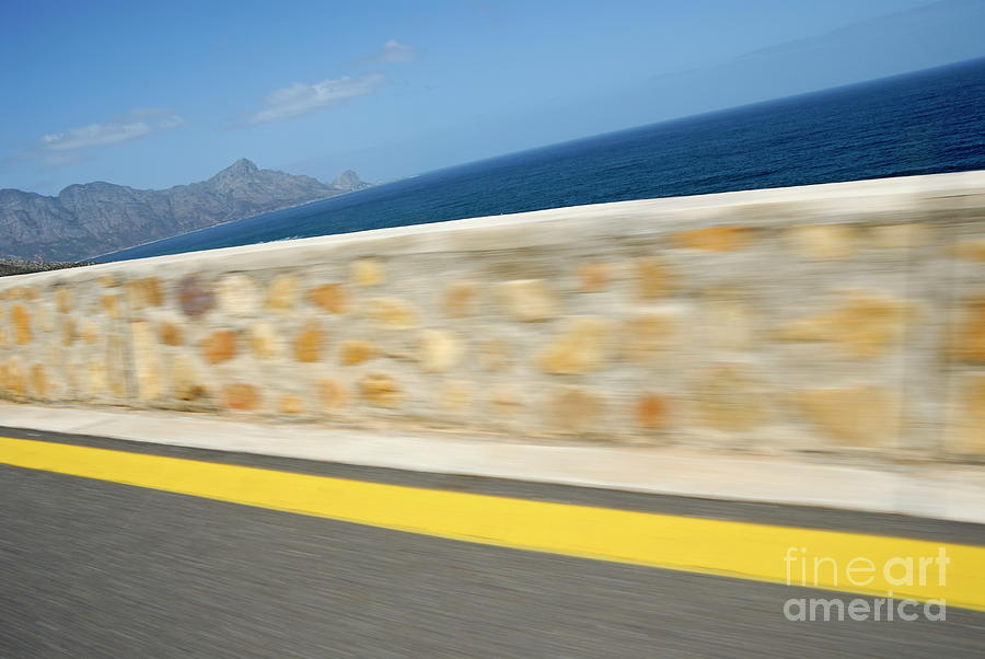Yellow Line On A Coastal Road By Sea Photograph