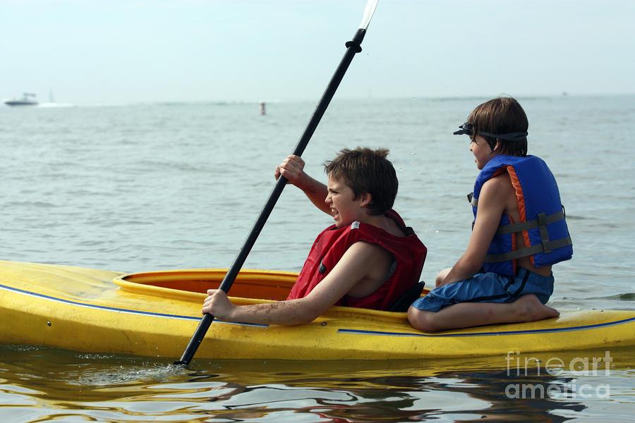 Young boys playing on a kayak Photograph - Young boys playing on a kayak ...