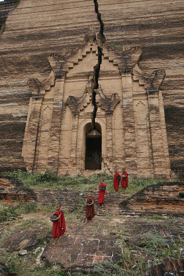 Young Buddhist Monks Near A Ruined Photograph  - Young Buddhist Monks Near A Ruined Fine Art Print