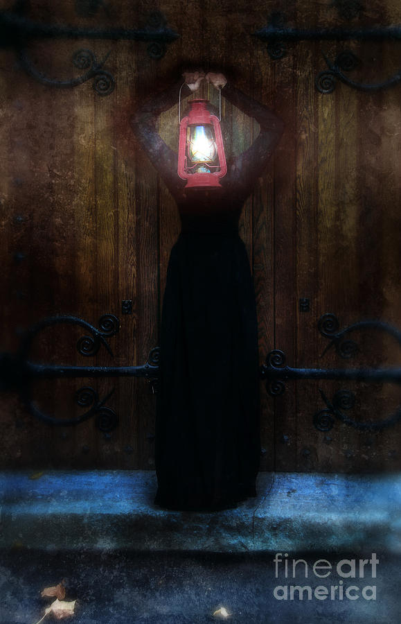 Young Woman In Black Lantern In Front Of Her Face Photograph