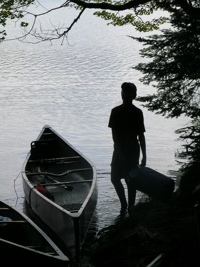 Youth With Canoe Photograph  - Youth With Canoe Fine Art Print