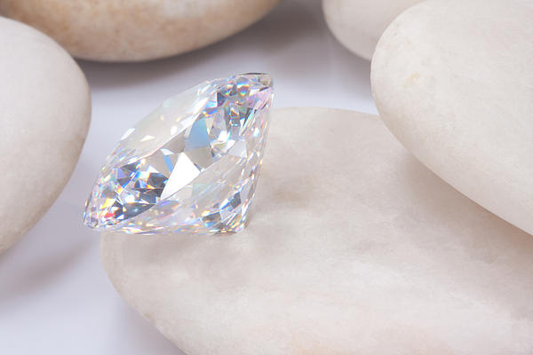 Diamond On White Stone Print by Atiketta Sangasaeng