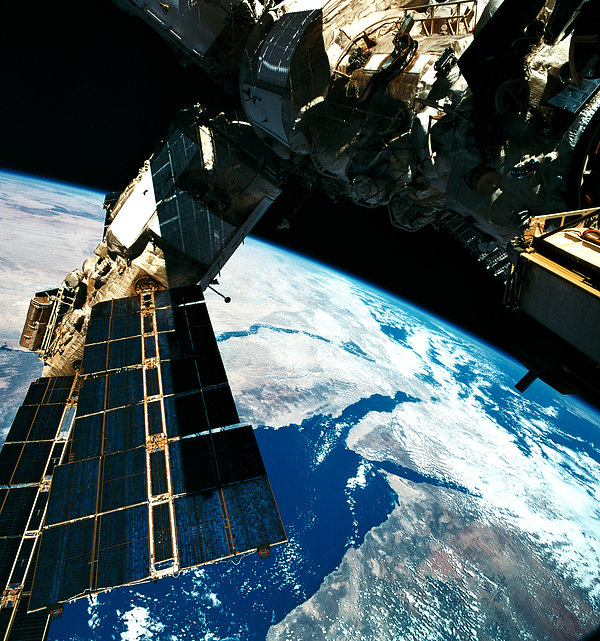 A Satellite Orbiting Above The Earth Print by Stockbyte