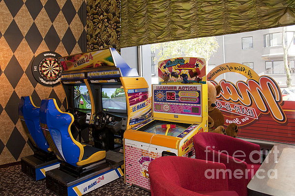 Arcade Game Machines At A Diner Print by Jaak Nilson
