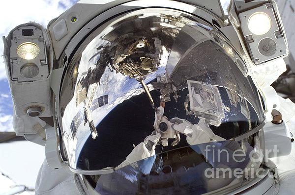 Astronaut Uses A Digital Still Camera Print by Stocktrek Images