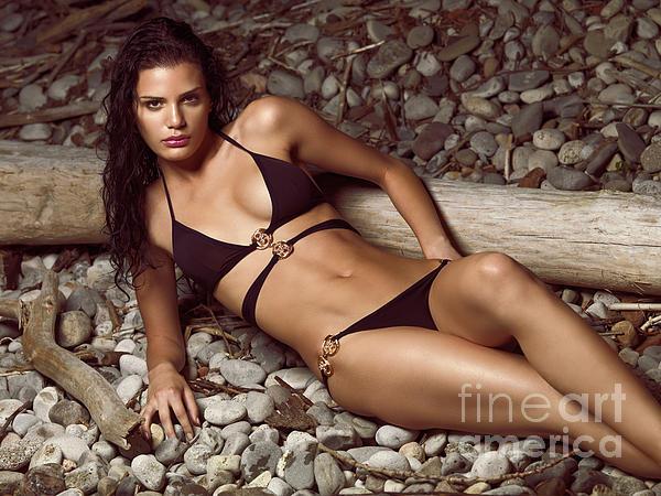 Beautiful Young Woman In Black Bikini On A Pebble Beach Print by Oleksiy Maksymenko