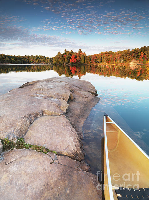 Canoe At A Rocky Shore Autumn Nature Scenery Print by Oleksiy Maksymenko
