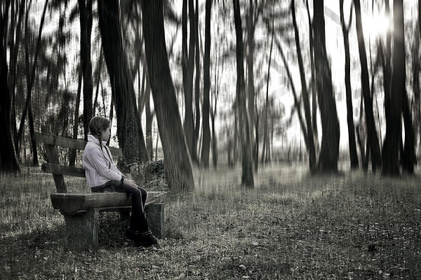 Girl Sitting On A Wooden Bench In The Forest Against The Light Print by Joana Kruse