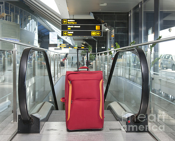 Luggage At The Top Of An Escalator Print by Jaak Nilson