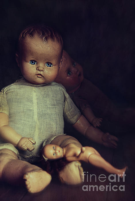 Old Dolls Sitting On Wooden Table Print by Sandra Cunningham