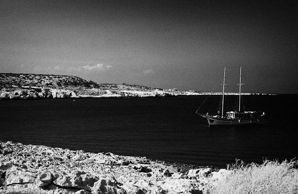 Sailing Boat Moored In A Quiet Bay Near Cape Gkreko Greco Republic Of Cyprus Print by Joe Fox