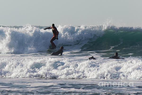 Surfers At Porthtowan Cornwall Print by Brian Roscorla