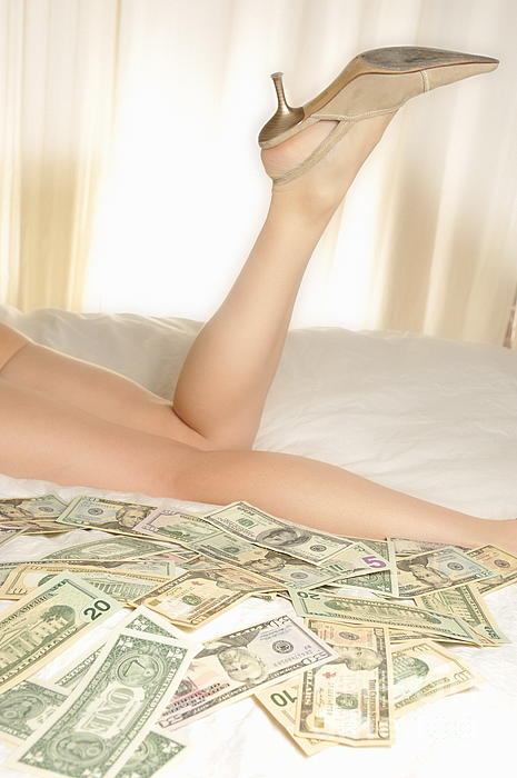 Woman Lying On Bed With Us Dollars Print by Sami Sarkis