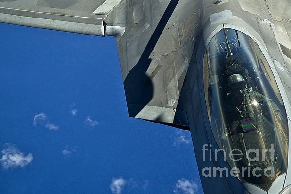 An F-22 Raptor In Flight Print by Stocktrek Images