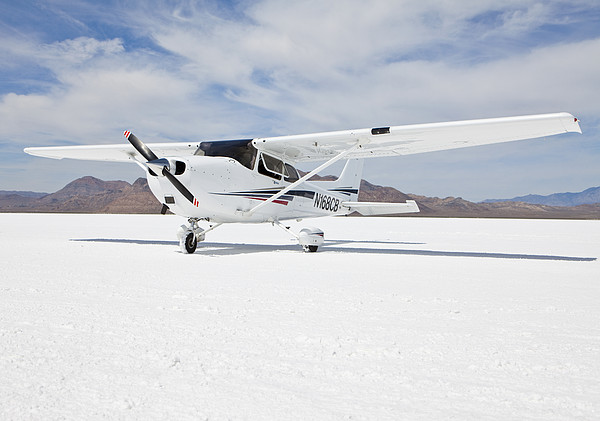 Cessna Aircraft On Bonneville Salt Flats Print by Paul Edmondson