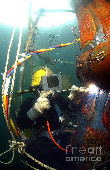 U.s. Navy Diver Welds A Repair Patch Print by Stocktrek Images