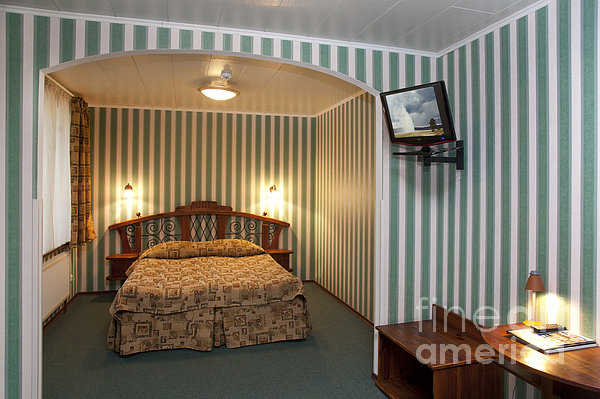 Bed In Hotel Room Print by Jaak Nilson