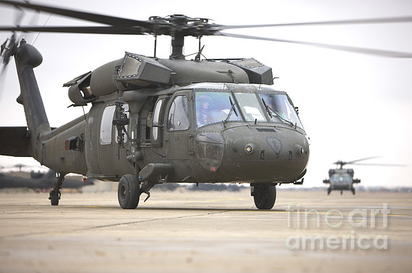 A Uh-60 Black Hawk Taxis Print by Terry Moore