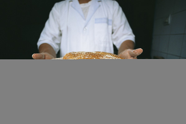 A Baker Shows His Fresh Loaves Print by Heather Perry