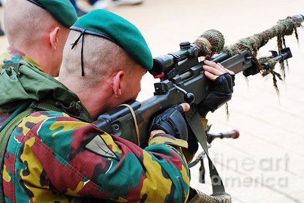 A Belgian Paratrooper Handling A Sniper Print by Luc De Jaeger