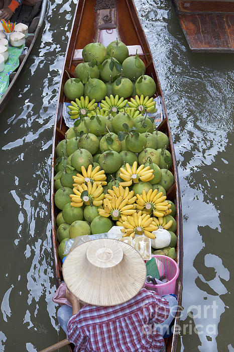 A Boat Laden With Fruit At The Damnoen Saduak Floating Market In Thailand Print by Roberto Morgenthaler