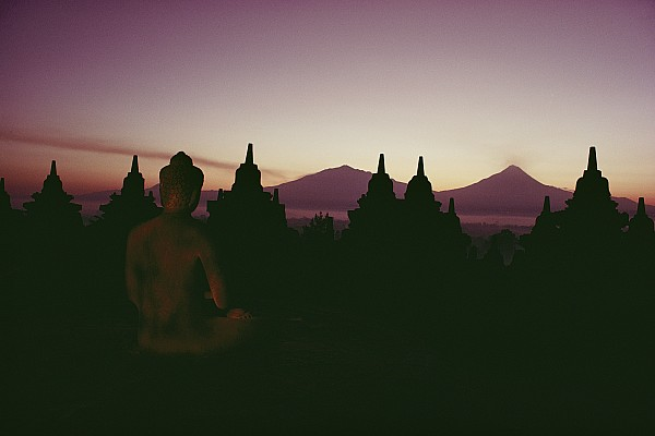 A Buddha Sits In The Print by Dean Conger