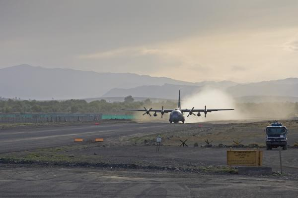 A C-130 Taking Off Print by Tim Grams