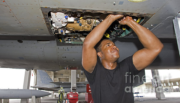 Kadena Decorative Pillow : A Crew Chief Performs Work On An F-15 by HIGH-G Productions
