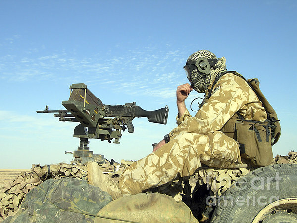 A Gunner Sits Atop A British Army Wmik Print by Andrew Chittock