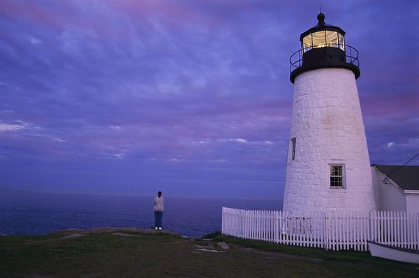 A Lighthouse Visitor Enjoys A Twilight Print by Stephen St. John