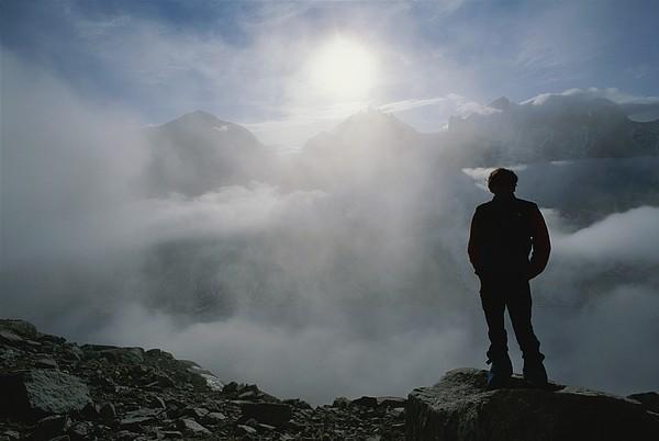 A Man In Silhouette Looking Print by Gordon Wiltsie