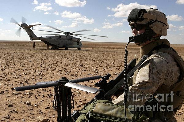 A Marine Assembles A Radio Antenna Print by Stocktrek Images