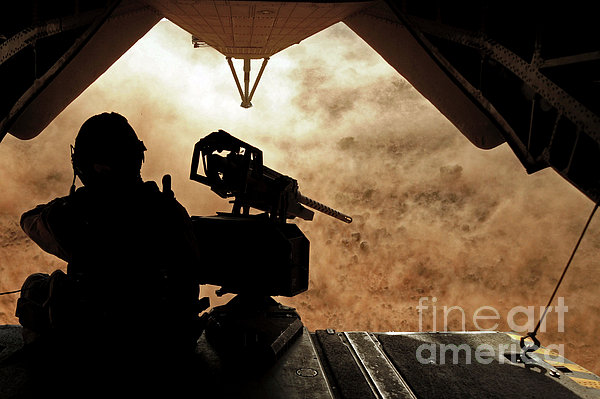 A Marine Waits For Dust To Clear While Print by Stocktrek Images