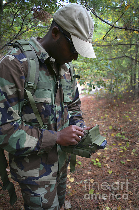 A Military Technician Uses A Pda Print by Michael Wood