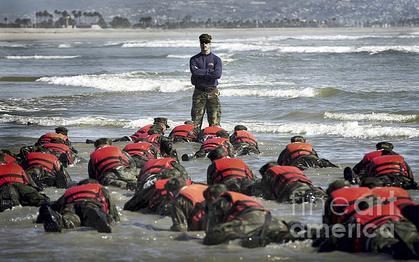 A Navy Seal Instructor Assists Students Print by Stocktrek Images