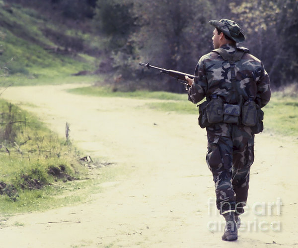 A Navy Seal Patrols Down The Road Print by Michael Wood