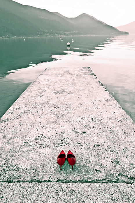 A Pair Of Red Women's Shoes Lying On A Walkway That Leads Into A Print by Joana Kruse