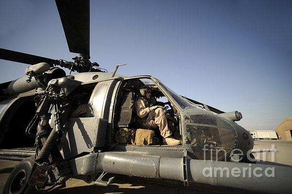 A Pilot Sits In The Cockpit Of A Hh-60g Print by Stocktrek Images