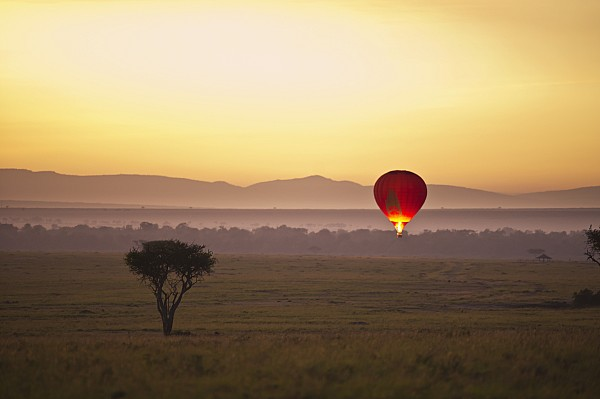 A Red Hot Air Balloon Takes Flight Print by David DuChemin