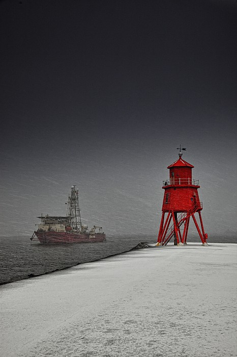 A Red Lighthouse Along The Coast In Print by John Short