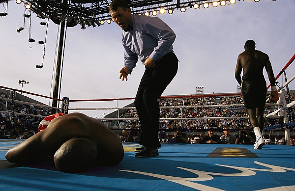A Referee Counts Out A Fallen Boxer Print by Maria Stenzel