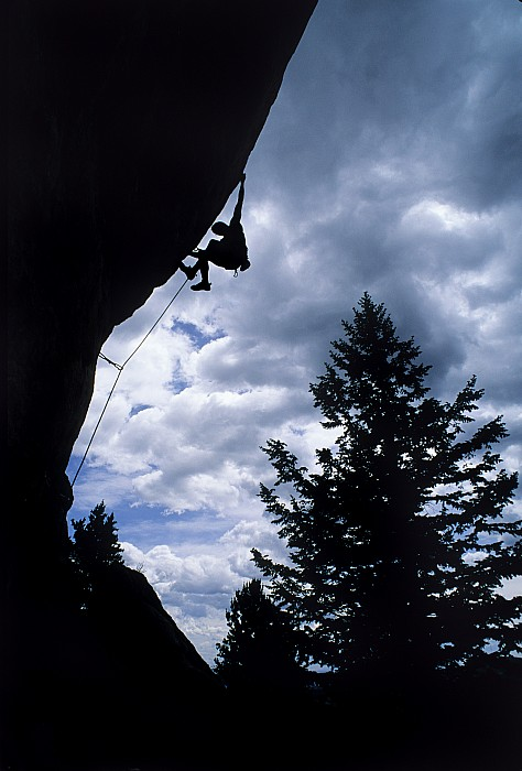 A Rock Climber Ascends A Steep Route Print by Bill Hatcher