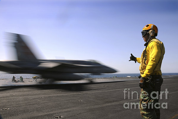 A Sailor Ensures An Fa-18c Hornet Print by Stocktrek Images