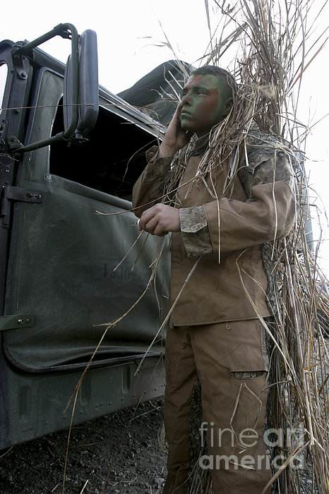 A Scout Observer Applies Camouflage Print by Stocktrek Images